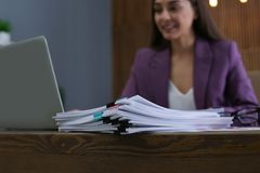 Stack of documents and blurred businesswoman stock photos