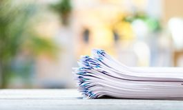 A stack of documents on a bright background stock image