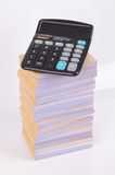 Stack of documents and calculator Stock Photo