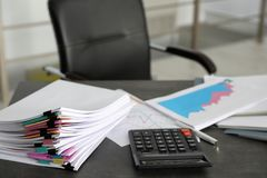 Stack of documents and calculator royalty free stock images