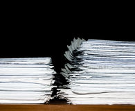 Stack of documents or files, overload of paperwork. Heap, two stacks of documents or files, overload of paperwork on black background royalty free stock photos