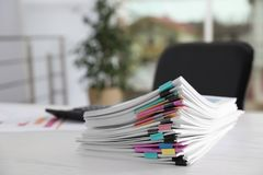 Stack of documents with paper clips on office table. royalty free stock images