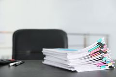 Stack of documents with paper clips on office table stock photo