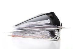Stack of documents on white background. Stack of documents in binders against white background Stock Image