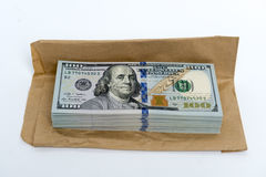 Stack of dollar banknotes and brown envelope Royalty Free Stock Photo