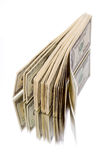Stack of dollar bills. Stack of $100 dollar bills.  on white background Royalty Free Stock Images