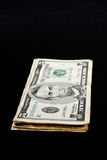 Stack of dollar bills. Isolated on black background royalty free stock image
