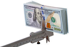 Stack of $ 100 dollar bills and caliper Stock Photos