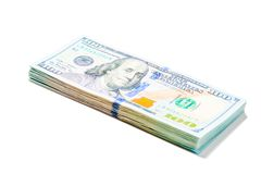 Stack of 100 dollar bills piled on white background. Isolated stock photo