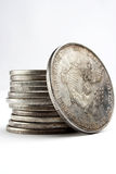 Stack of dollars and coins. Stack of old dollars and coins Royalty Free Stock Images