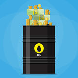 Stack of dollars and coins on oil barrel Stock Photo