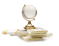 The stack of dollars with crystal globe Stock Photography