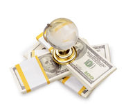 The stack of dollars with crystal globe Stock Image