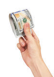Stack of dollars in hand Stock Images