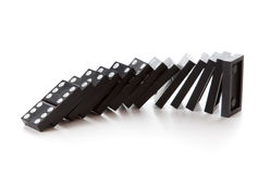 Stack of dominoes falling Stock Image