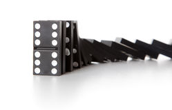 Stack of dominoes falling Stock Photo