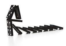 Stack of dominoes falling Royalty Free Stock Photography