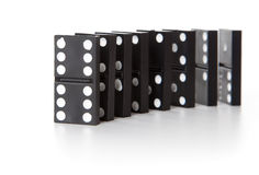 Stack of dominoes falling Stock Photos