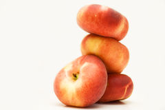 Stack of Donut Peaches. 4 donut peaches  on white Royalty Free Stock Photos