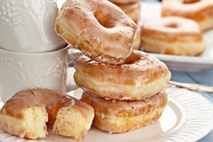 Stack of Donuts and Cups Royalty Free Stock Images