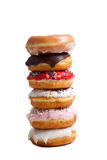 Stack of donuts on a white background Royalty Free Stock Image