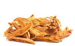 Stack of dried mango slices. Isolated on white background Stock Photo
