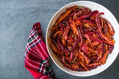 Stack of Dried Red Chili or Chilli Cayenne Pepper in Bowl royalty free stock photos