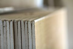 Stack of drywall plates leaning against a wall.  Royalty Free Stock Image