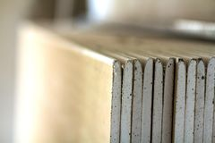 Stack of drywall plates leaning against a wall Royalty Free Stock Image