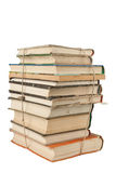 Stack of dusty books. On white background royalty free stock photo