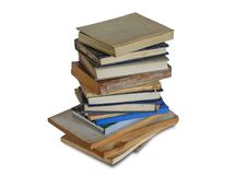 A stack of dusty shabby books. On a white background, isolated Stock Photos