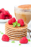 Stack of Dutch caramel waffles with fresh raspberry and cup of Stock Photography