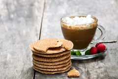 Stack  of Dutch caramel waffles with fresh raspberry and cup of. Coffee Stock Photo