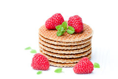 Stack of Dutch caramel waffles with fresh raspberry and cup of. Stack  of Dutch caramel waffles with fresh raspberry and cup of milk Stock Photo