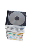Stack of dvds and cds. Over a white background royalty free stock image