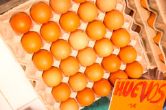 Stack of eggs in carton box at the market Royalty Free Stock Photos