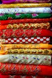 A Stack of Embroidered Patterned Fabrics stock photography
