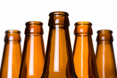 Stack of empty beer bottles. Closeup of bottle necks isolated on white Royalty Free Stock Photo