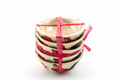 Stack of empty bowl overturn for sale tied with string. Royalty Free Stock Images