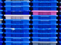 Stack of empty colorful plastic fishery containers Royalty Free Stock Images