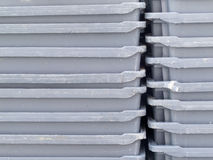 Stack of empty grey plastic fishery containers. Background texture pattern of stacks of empty grey plastic containers as used in fishery, wholesale, storage of stock photo