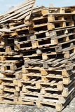 Stack of empty pallets in warehouse Stock Photos