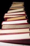 Stack of encyclopedia books over black background Stock Photo