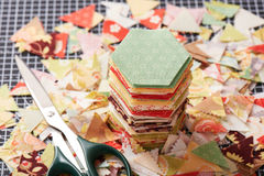 Stack english paper pieced hexagons surrounded by scraps Royalty Free Stock Photos