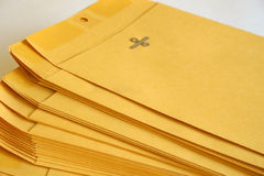 Stack of envelopes. Stack of manilla envelopes on white background royalty free stock photo