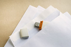 Stack envelopes and flash drive Royalty Free Stock Image