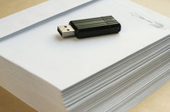 Stack envelopes and flash drive Royalty Free Stock Photo
