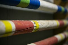 Stack of equestrian jumping poles in various colors royalty free stock photos