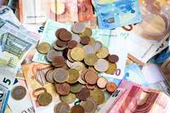 Stack of euro banknotes and coins royalty free stock photography