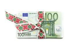 Stack of Euro banknotes with ribbon. 100 Euro banknotes. stock photography